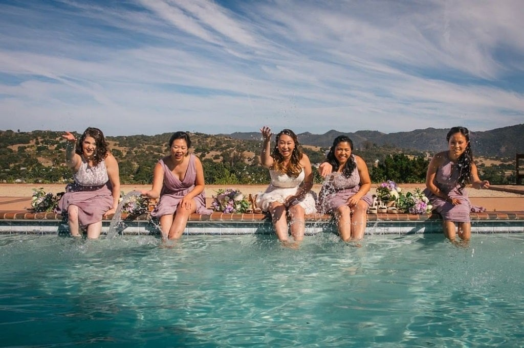The brides party enjoying the refreshing pool and the beautiful views at The Casitas Estate in San Luis Obispo